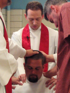 Hands being laid on Jamison.  That's Pastor Matt Brown directly behind him. I'm on the left.