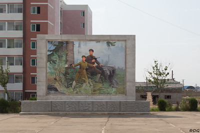 North Korea, Sariwon. Mosaic of Kim Il-sung protected by his wife Kim Jong-suk.