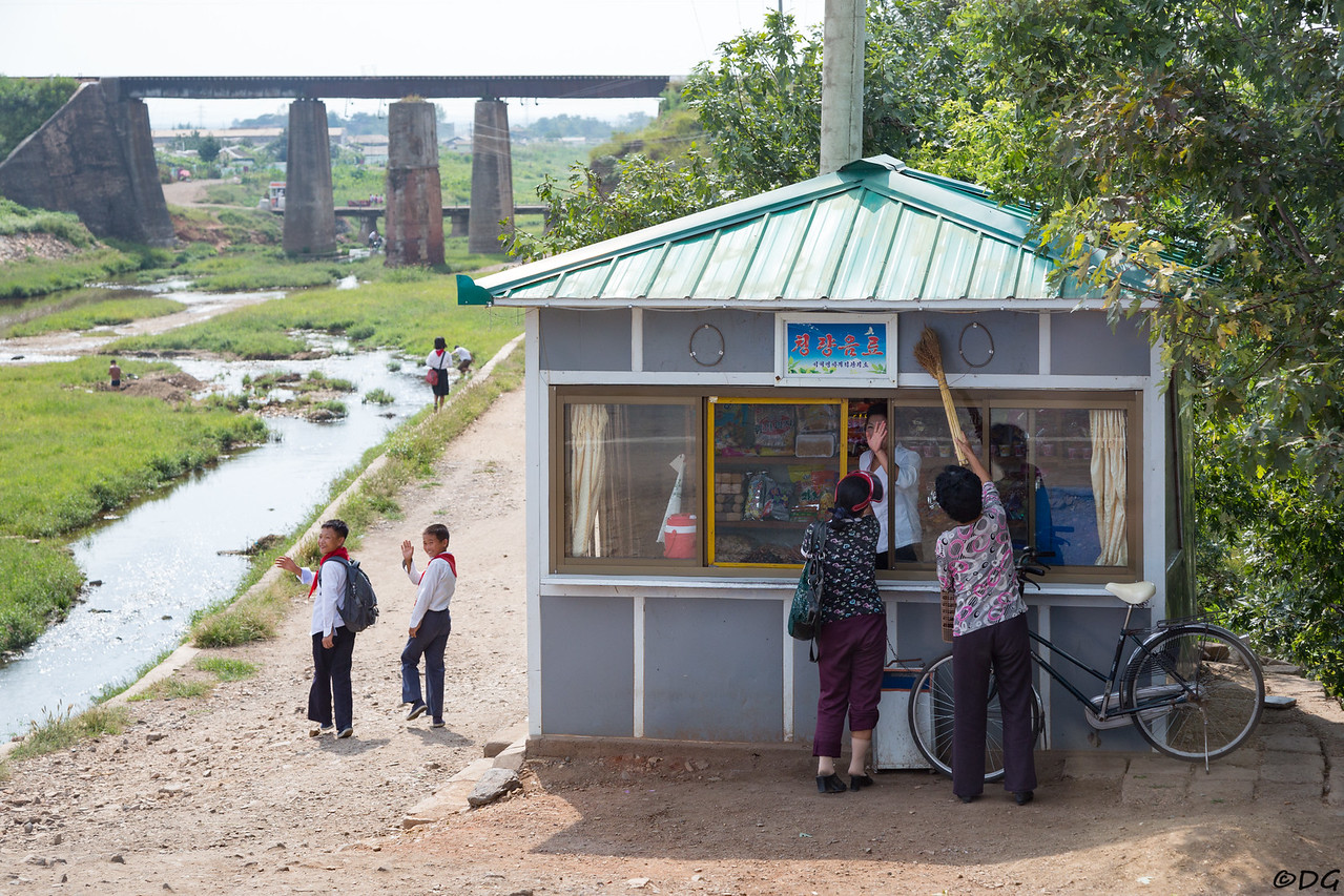 North Korea, Sariwon. Small kiosk just north of Sariwon.