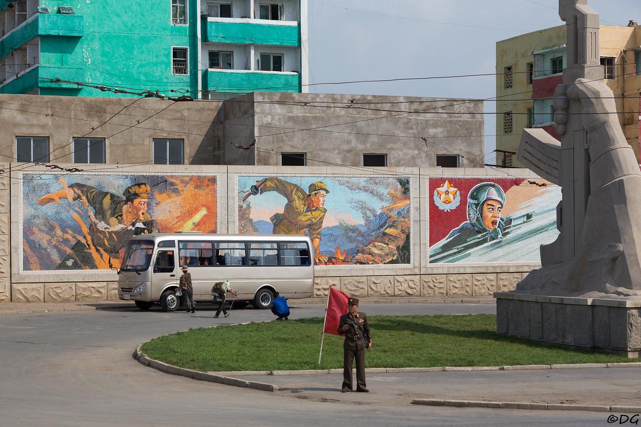North Korea, Sariwon. Mosaics and monument at north entrance of Sariwon.