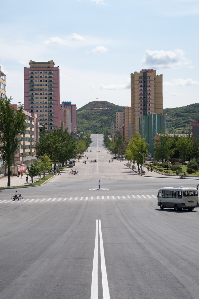 North Korea, Kaesong.  Traffic cop trying to keep up with mid day rush hour.
