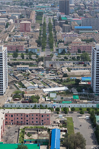 North Korea, Pyongyang. A mix of new apartment blocks and old housing with backyards and small plots a few hundred meters from the Juche Tower.