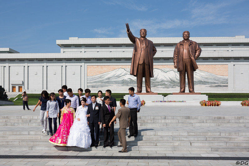 North Korea, Pyongyang. Wedding party at Mansu Hill Grand Monument.