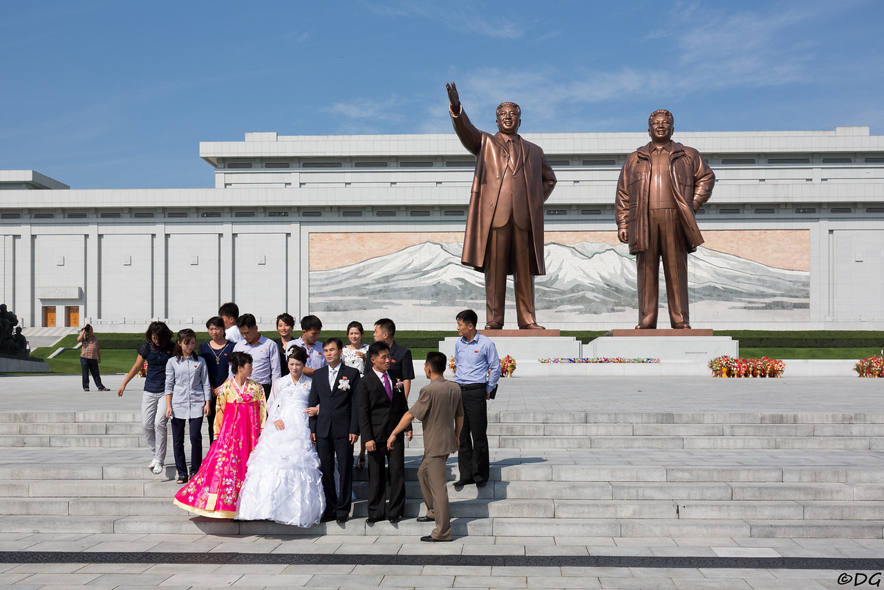 North Korea, Pyongyang. Wedding party at Mansu Hill Grand Monument.