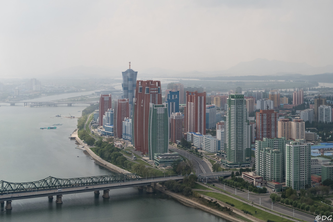 North Korea, Pyongyang. View from Yanggakdo Hotel to the southwest. Behind Yanggak Bridge the new high rise apartments on Mirae Scientists Street.
