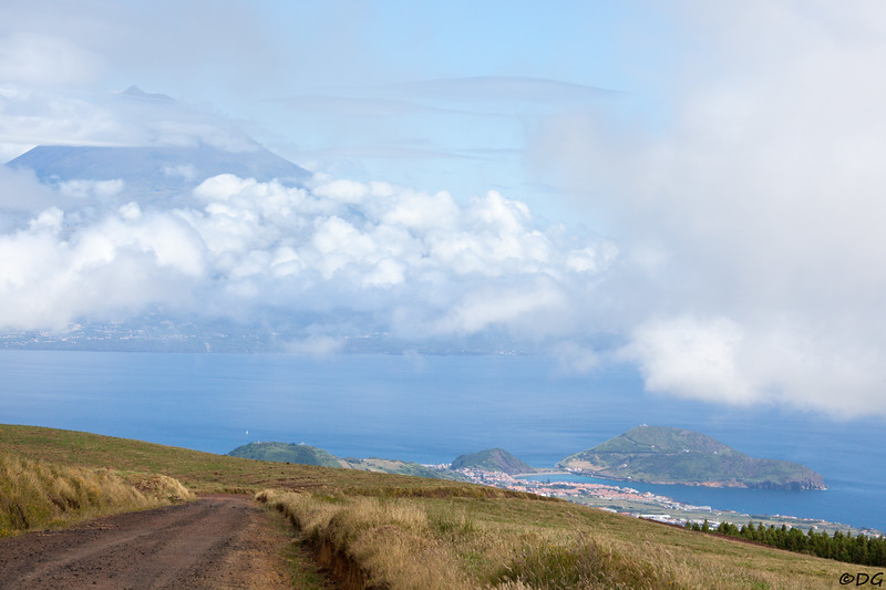 Portugal, Azores, Faial: View from about 800 meters altitude down to the town of Horta, Porto Pim bay and to the right, Monte da Guia. On the other side of the channel the island of Pico and it's majestic mountain can be seen.
