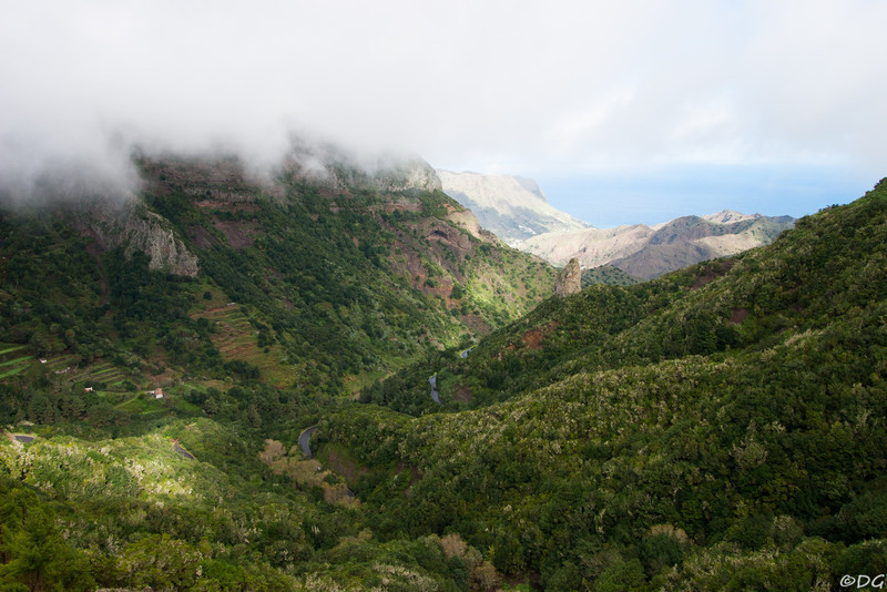 Spain, La Gomera, Valle de Hermigua: The winding road down to Agulo passes below Roque el Rejo.