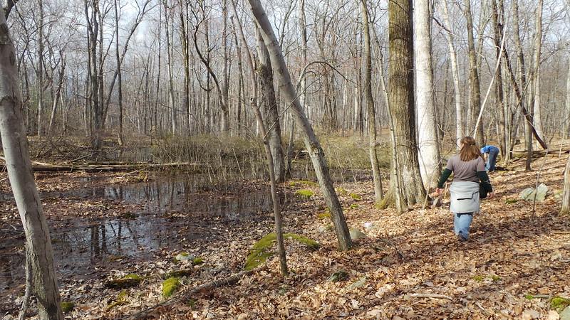 Sona and Egbert near vernal pond in Camp Monroe.