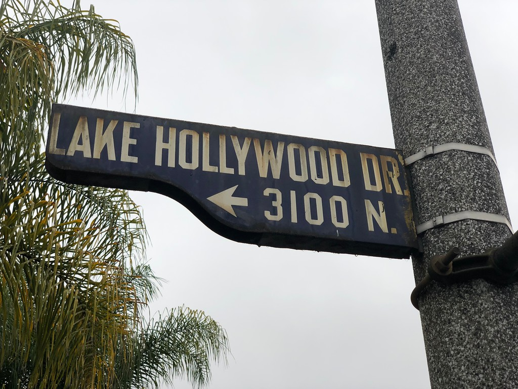 Go up Lake Hollywood Drive in Los Angeles and it will take you directly to the Lake Hollywood Park to see the Sign.