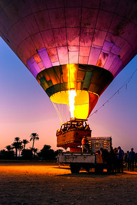 Hot Air Balloon with Tourists Taking off at Dawn from a Truck in Egypt