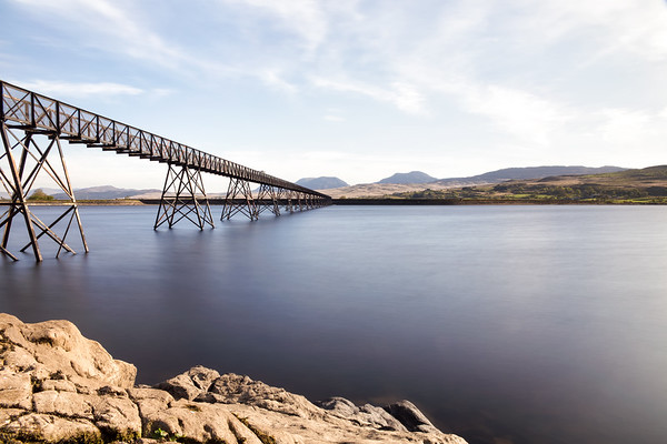 An Old Foot Bridge Spans a Lake in the Mountains of Wales