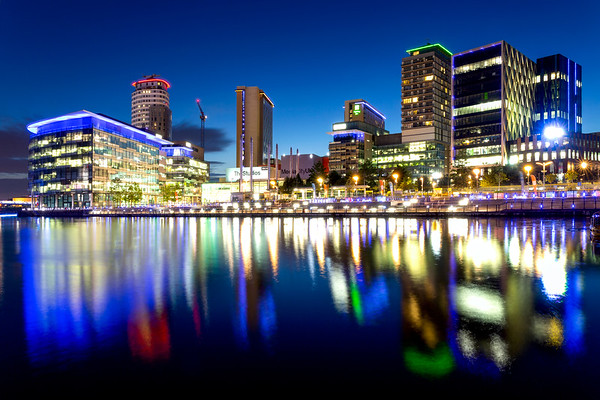 Manchester Skyline at Salford Quays Illuminated at Night and Reflected in the Water