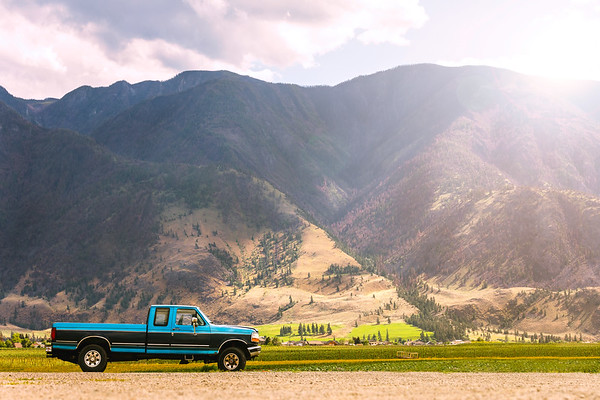 Truck at the Roadside in British Columbia with Mountains Behind