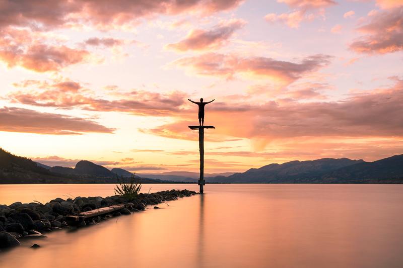 Standing Silhouette at Sunset over Lake Okanagan in British Columbia
