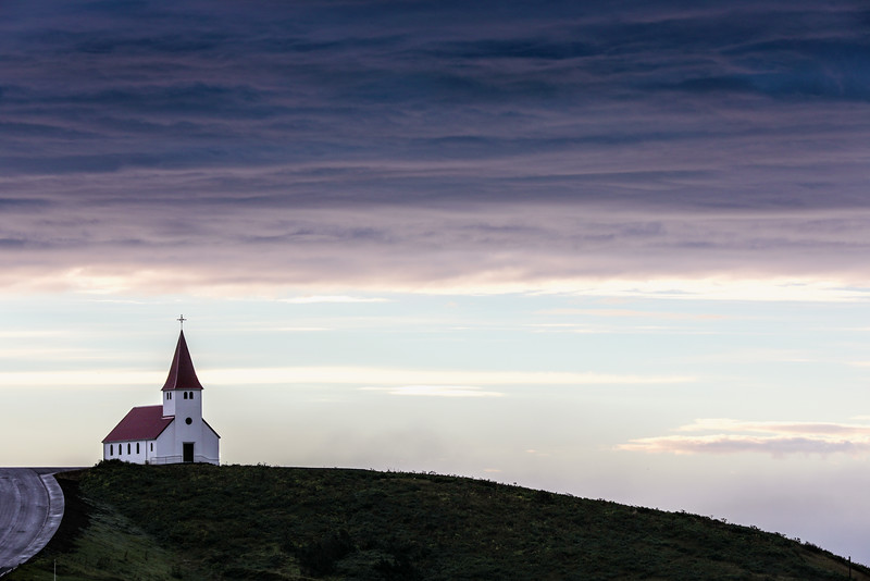 A tiny chapel on a hill overlooking the small town of Vik, Iceland