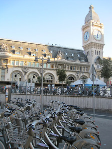 Gare de Lyon is one of the six large railway termini in Paris, France. It is the northern terminus of the Paris–Marseille railway. It is named after the city of Lyon, a stop for many long-distance trains departing here, most en route to the south of France.  The station was built for the World Exposition of 1900.  Most notable is the large clock tower atop one corner of the station, similar in style to the clock tower of the United Kingdom Houses of Parliament, home to Big Ben.  http://en.wikipedia.org/wiki/Paris-Gare_de_Lyon