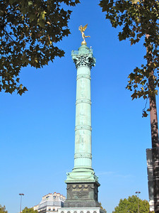 """Place de la Bastille. The column surmounted by the gilded """"Spirit of Liberty"""" on place de la Bastille was erected to commemorate not the surrender of the prison in 1789, but the July Revolution of 1830, that replaced the autocratic Charles X with the """"Citizen King"""" Louis-Philippe.   http://france-for-visitors.com/paris/bastille.html"""