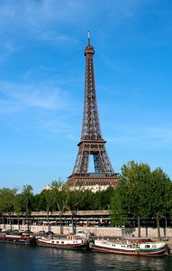 Tour Eiffel by the river Seine: 300 m (985 ft) tall  Built for the 1889 International Exhibition, Paris, the centenary celebration of the French Revolution.