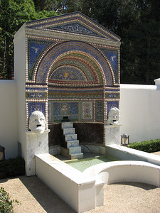 in the East Garden, a colorful fountain with shells and theater masks (a replica of an ancient fountain from the House of the Large Fountain in Pompeii.