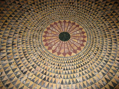 The elaborate floor in the Temple of Herakles is a replica of a floor from the Villa dei Papiri. It is composed of alternating triangles of Numidian yellow and africano or dark gray Lucullan marble.