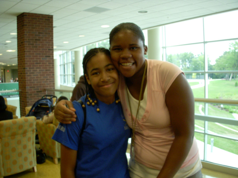 Here's K with one of the new friends she made there.  S is in the teen ministry and was so warm and welcoming to K.