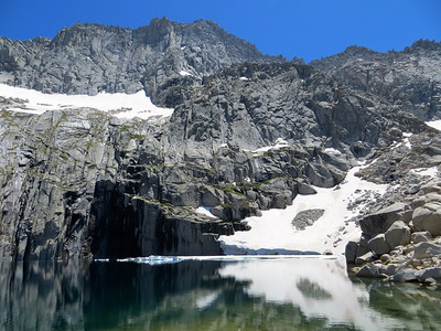 Precipice Lake is nestled beneath the north wall of Eagle Scout Peak