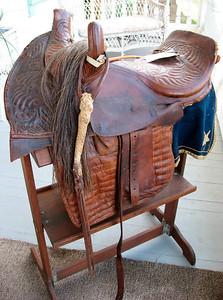 Sidesaddle for woman http://en.wikipedia.org/wiki/Sidesaddle