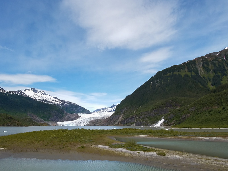 Mendenhall Glacier and melt waterfall from an observation point outside Juneau, Alaska.