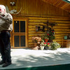 Homesteader Alaskan shows off his cabin in Cooper Landing, Alaska.
