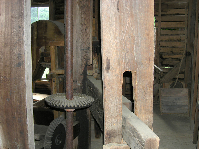The drive mechanism that converts water energy to grinding power at Mingus Mill.