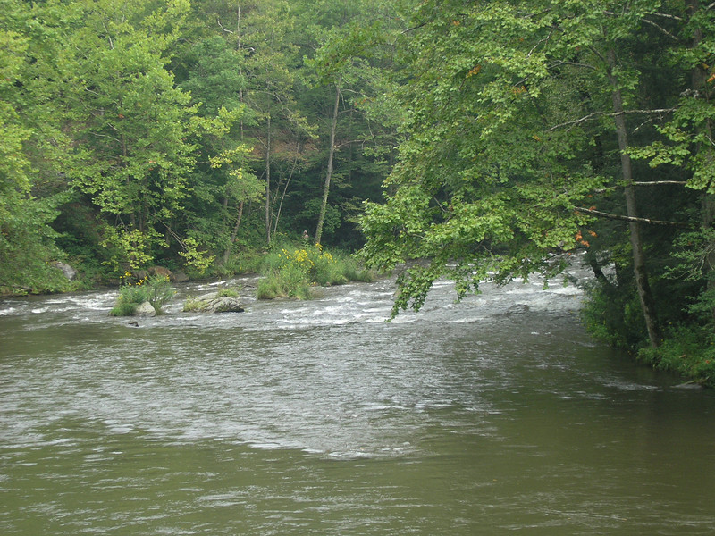 Fast running river next to the Smoky Mountains Railroad tracks.