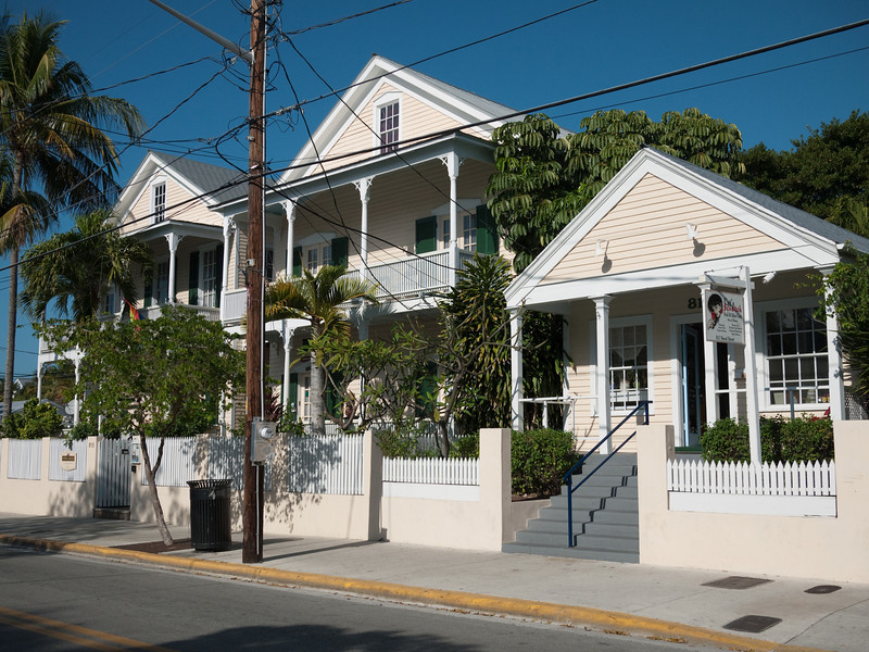 Walking by local homes and cottage businesses in Key West.
