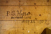 History on the wall of the Wm. Hyman's store storage building. Gaspe, Quebec, Canada.