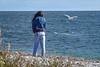 Tourist making birdie friends in Forillion National Park, Gaspe, Quebec, Canada.
