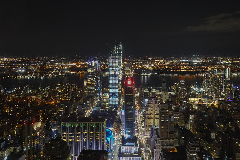 NYC at night from the 86 floor of the Empire State Bldg looking towards the East River.