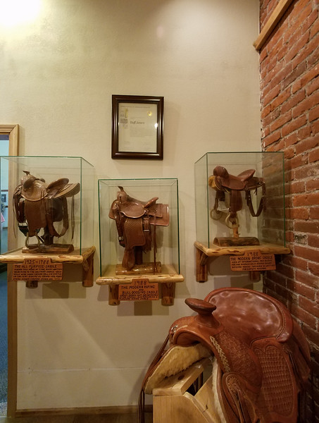 Four of Duff Severe's miniature saddles in a Pendleton display.