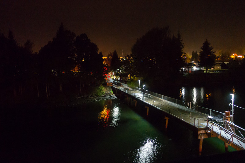 The Stevenson, WA. dockage at night with the town in the background.