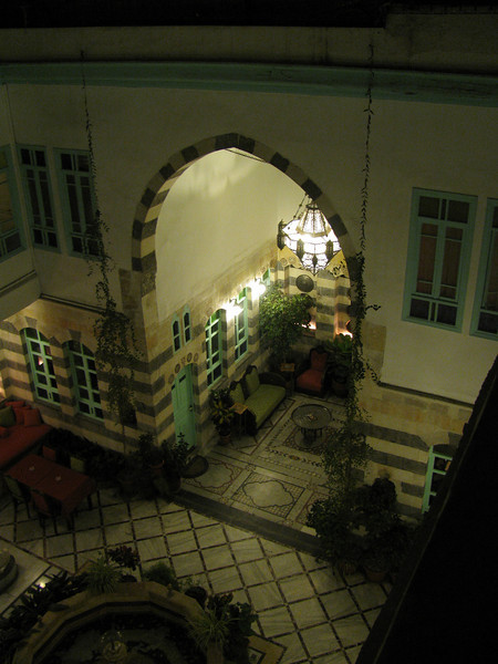 Turning of the bustling alley into this calm courtyard of the old merchants house now our hotel