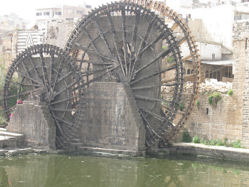 Early water wheel lifts water to irrigation canal at Hama in Syria