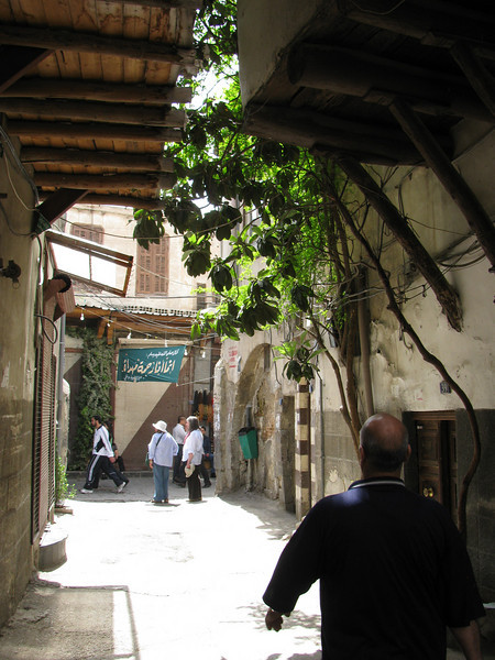 The jettied storeys of Damascus old city shelter narrow alleys