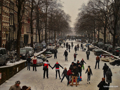 Amsterdam - ice skating crowd on the frozen canal