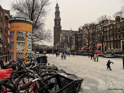 Amsterdam - ice skating on the frozen canal