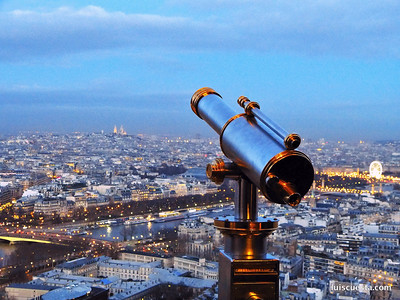 classic design telescope on the Eiffel Tower