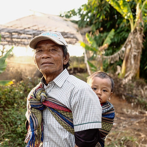 Vietnamese minority grandfather with baby