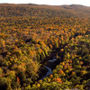 Fall leaves ablaze in color in Porcupine Mountains Wilderness State Park, Ontonagon, Michigan. This portion of Michigan's Northern Peninsula, near Lake of the Clouds, is one of the state's most popular autumn destinations.  Copyright - W. Keith Baum | PhotoCanal.com
