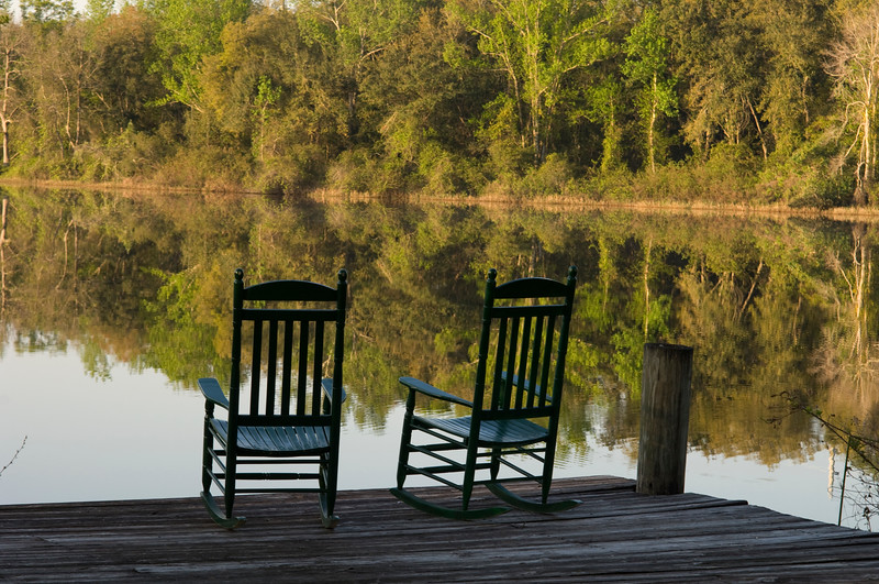 Delicieux Two Rocking Chairs On A Dock On A Lake With Trees Reflected In Water, Miami