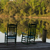 Two rocking chairs on a dock on a lake with trees reflected in water, Miami,FL.  Copyright - W. Keith Baum | PhotoCanal.com