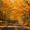 Autumn drives. Roadway through the autumn leaves in the Upper Peninsula of Michigan.  Copyright - W. Keith Baum | PhotoCanal.com