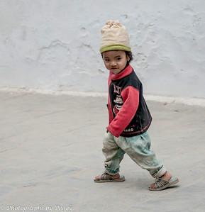 Tibetan Boy at Bodhnath Stupa Kathmandu