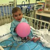 A happy Mustafa ready to go home with his balloon. God is good!